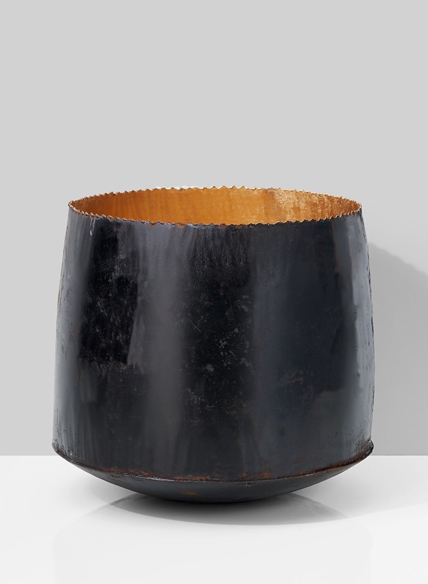 black iron bowl planter with gold inside