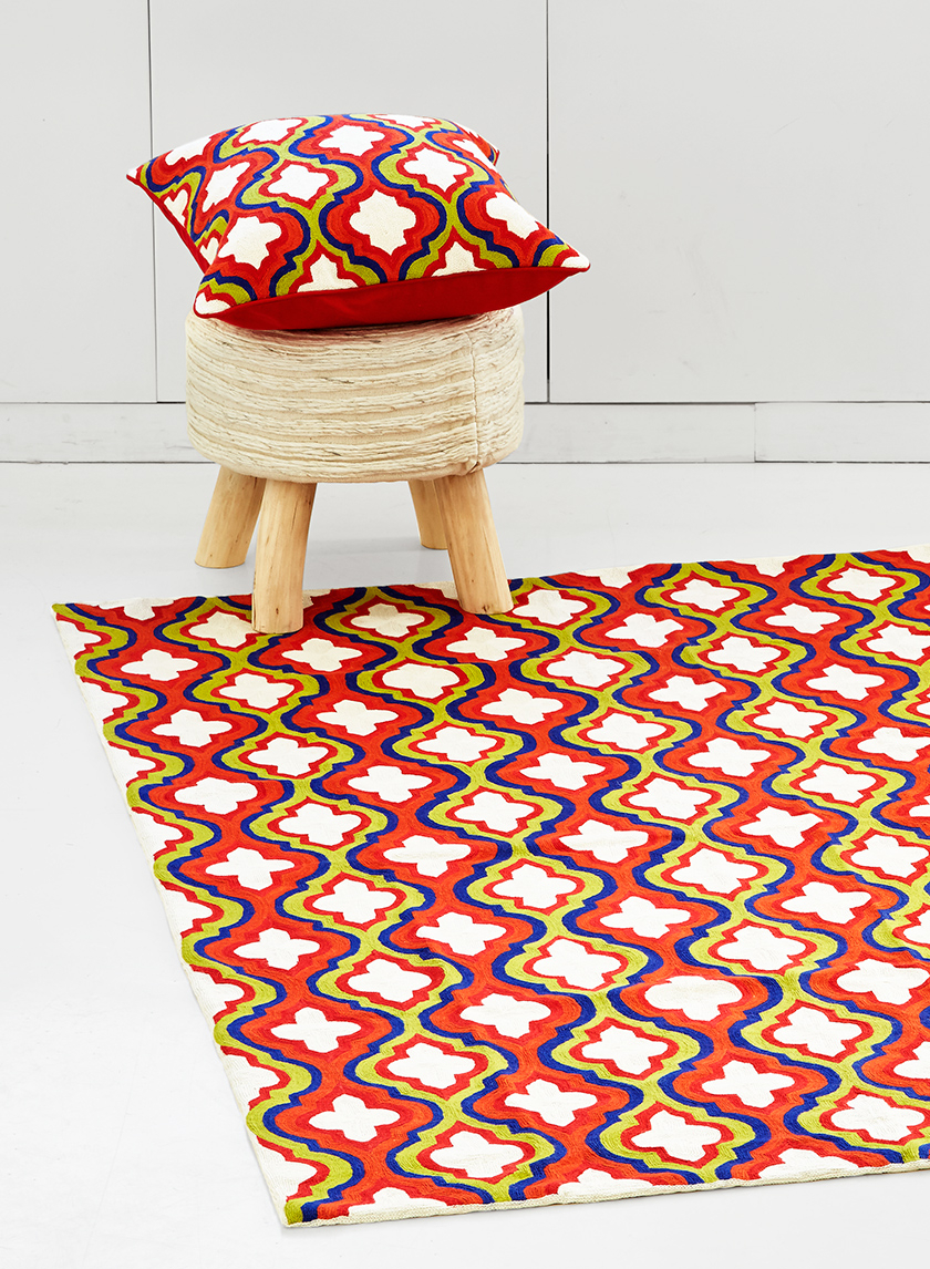 embroidered wool rug matching pillow