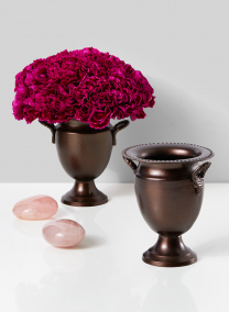 bronze flower urn with pink carnations