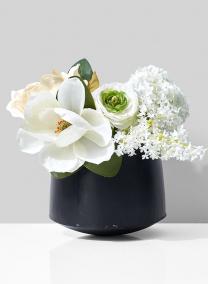 silk magnolia ranunculus floral arangement