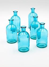 Blue medicine bottle bud vase