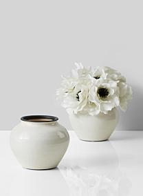 glazed white ceramic fishbowl vase with anemones