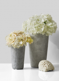 cement flower vases with hydrangeas and roses