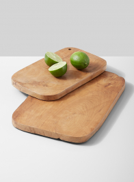teak cutting board herbs lime lemon