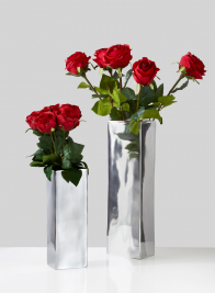modern polished aluminum metal vase with red roses