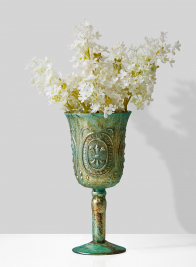 white lilac in goblet vase centerpiece
