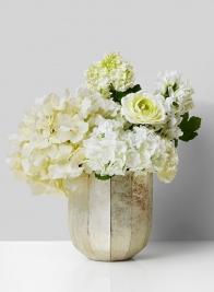 white flower centerpiece in pearl glass vase