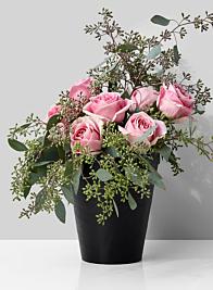 black iron gold vase roses eucalyptus