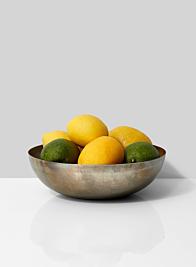 lemons limes in metal fruit bowl