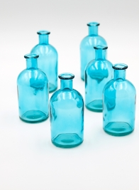 Blue medicine bottle bud vase