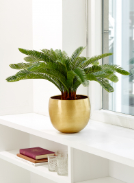 potted fake sago palm tree in brass planter