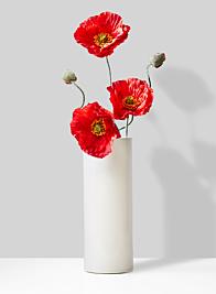 modern icelandic poppy arrangement in ceramic vase