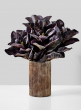 purple magnolia arrangement in vintage look glass vase