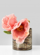 poppies in patterned glass vase