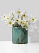 white cosmos arrangement in patina glass vase