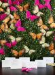 boxwood butterflies escort card table backdrop idea